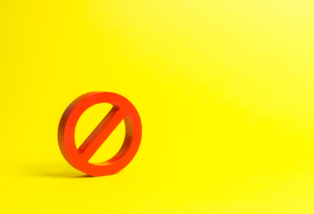 No sign or No symbol on an yellow background. Minimalism. The concept of prohibition and restriction. Censorship, control over the Internet and information. Restrictive laws. Crazy laws printer.
