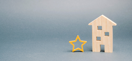 Wooden house and one star. Concept of negative feedback. Low quality and service serving. Evaluation of the critic. Hotel or restaurant rating. Bad critic review. Place for text Stock Photo