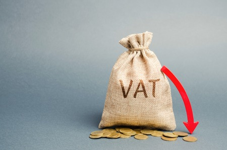 Money bag with coins and down arrow. Reduced VAT and tax burden. Improving the competitiveness of goods and services. Tax relief. Stimulate the economy. Value-added tax