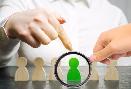 Woman leader chooses the person in the the team. Human Resource Management. Talented worker. Hiring staff. Employee search. Promote. Choosing a new leader in the team. Dismissal. Successful choice.