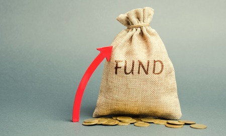 Money bag with the word Fund and up arrow. The concept of increasing the payroll. Investing in securities investors. Growing market value. Wealth, stability, safe investment. Financial resources Banco de Imagens