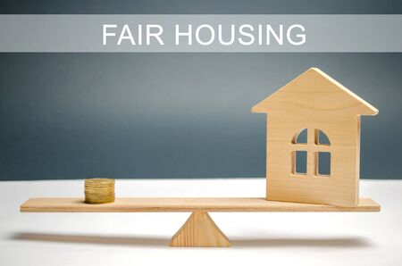 Money and house on the scales with the inscription Fair housing. Home appraisal. Property valuation. Housing evaluator. Fair trade. Legal transparent deal. Apartment purchase  sale.