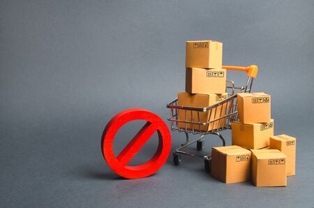 Cardboard boxes, supermarket trolley and red symbol NO. Embargo, trade wars. Restriction on the importation of goods, proprietary for business. Inability to sell products, poor logistics. No delivery.