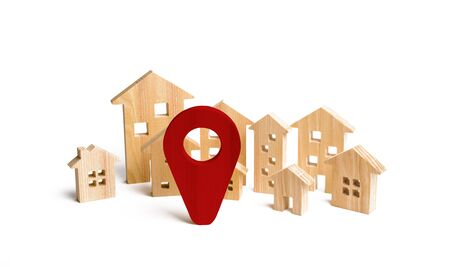 Wooden city and houses location sign. concept of rising prices for housing or rent. Growing demand for housing and real estate. The growth of the city and its population. Investments. agglomeration