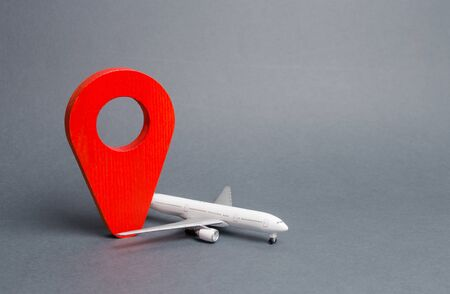 Red position pin and passenger airliner. Air travel and tourism, travel. Destination point. Free movement around the world and visa-free travel. airmail. Fast delivery of goods and products.