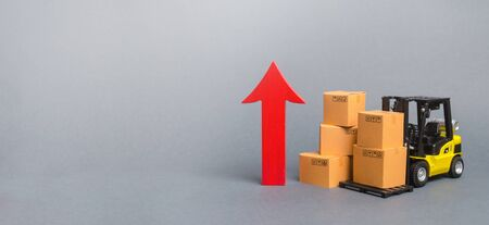 Yellow Forklift truck with cardboard boxes and a big red arrow up. trade between countries, popularity of national goods, economic rate growth production goods and products, Banner, copy space Archivio Fotografico