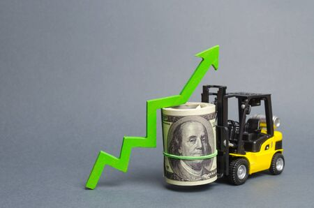 Yellow Forklift truck carries a big bundle of dollars and green up arrow. Growth of income and profit. progress of industrial and logistics industries, wage growth, Economic reforms, emerging markets
