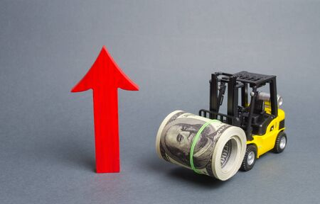 Yellow Forklift truck carries a big bundle of dollars and red arrow up. Economic reforms, emerging markets. Growth of income and profit. progress of industrial and logistics industries, wage growth