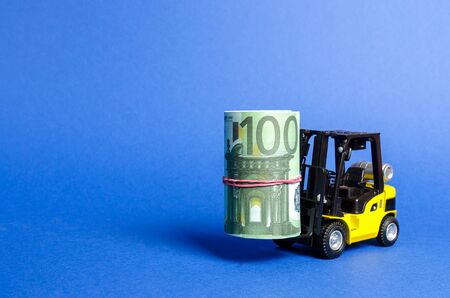 Forklift truck carries a bundle of Euro. Attracting direct investment in business and production, improving economic performance. capitalism. Export of capital, offshore economic zones.