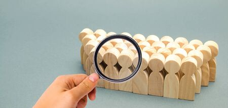 The crowd of wooden figures of people. Concept of business team. Labor collective. Teamwork. Employees. Human Resource Management. Labor market. Demographic situation. Population