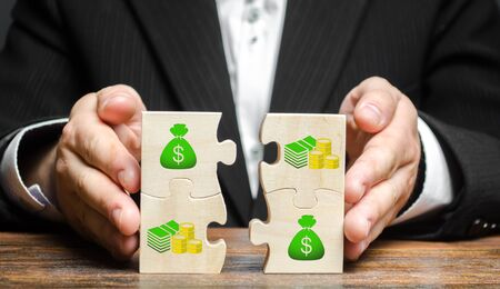 Businessman combines money puzzles. Fundraising, attracting investments for the implementation of business projects and startups. Crowdfunding. Accumulation of resources and money, opening a business.