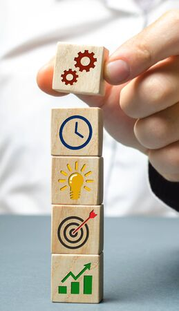 Businessman forms a business strategy. The concept of developing innovative technologies. Action plan, management, research, marketing. The goal to increase and maximize profit. Enterprise development 写真素材
