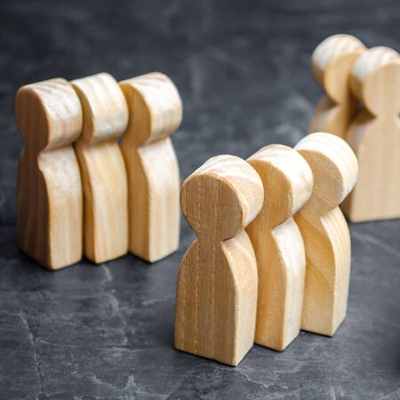 Groups of wooden people. The concept of market segmentation. Marketing segmentation, target audience, customer care. Market group of buyers. Customer analysis and customer relationship management