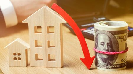 The concept of falling real estate market. Reduced interest in the mortgage. A decline in property prices and apartments. Low interest rates on mortgage loans. Reduced demand for home. selective focus
