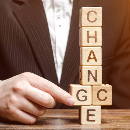 Businessman points to wooden blocks with the word Change to Chance. Personal development. Career growth or change yourself concept. Motivation, goal achievement, potential, incentive, overcoming