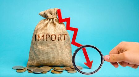 Money bag with the word Import and down arrow. The fall of imports. Reducing the competitiveness of imported goods. Sanctions and embargoes. Economic decline. Recession and crisis. Default