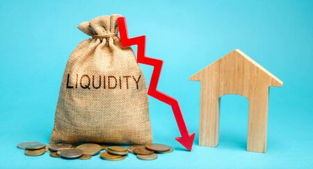 Money bag with the word Liquidity, down arrow and house. Unprofitable investment in real estate. High taxation. Low demand. Falling housing or rental prices. Expensive utilities and home maintenance