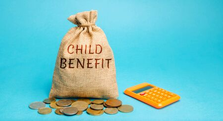 A money bag with the word Child benefit and calculator. Material assistance issued by the state per child for the purpose of social support for parents. Payments. Financial help