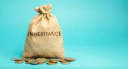 Money bag with the word Inheritance. Separation of inheritance between relatives or transfer of property to charitable organizations. Payment of taxes. Investment funds.