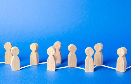 Chain of people figurines connected by lines. Cooperation and interaction between people and employees. Dissemination of information in society, rumors. Communication and social networks.