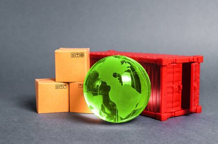 Red cargo container with boxes and green planet earth glass ball. Business and industry, transport infrastructure. The concept of commerce and trade, cargo delivery, exchange of goods. Globalization 版權商用圖片