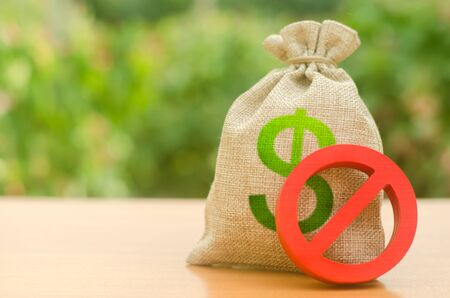 Money bag and red sign NO. Freeze assets and suspicious transactions. Money laundering. Restrictions on the export of capital, Economic pressure and sanctions. destabilization of the exchange market.