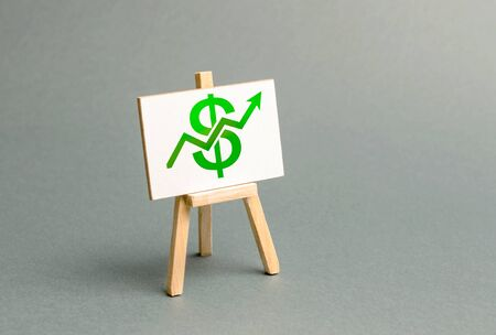 Information stand with a green dollar sign and up arrow. Increase profits and wealth. growth of wages, prices for manufactured and sold goods. Favorable conditions for business. Investment attraction