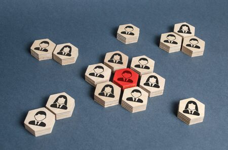 Hexagons with employees form the core around the red leader figure. Leadership and business management, team building, cooperation and brainstorming. Attracting specialists to the project. Imagens - 128846699