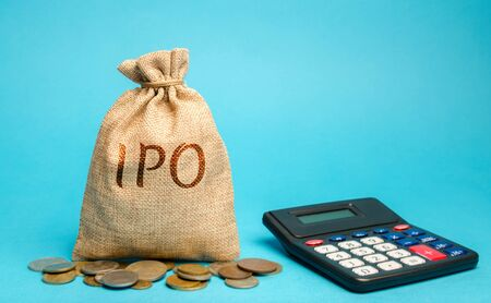Money bag with the word IPO (Initial public offering; stock market launch) and a calculator. The first public sale of shares of a joint stock company. Business and finance concept