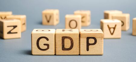 Wooden blocks with the word GDP ( Gross domestic product ). Financial measure of the market value of all the final goods and services produced in a specific time period. Banco de Imagens