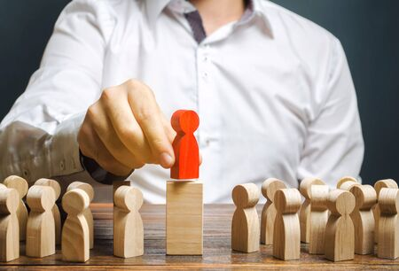 Team leadership concept and choosing a new leader. Choice of person. Hiring and recruiting. Human resource management. Talented worker. Wooden figures of people. Selective focus