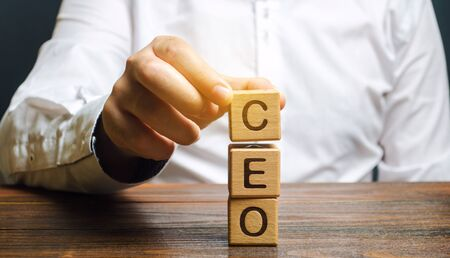 Wooden blocks with the word CEO and businessman. Chief Executive Officer. Boss, top management position in a team or company. Leader, Leadership. Business concept Banco de Imagens
