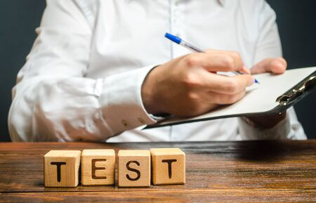 Word test and a man with a clipboard in the background. Quality control, audit. The inspector conducts a check. Organization, review. Pass inspection, permission for the business. Driving license