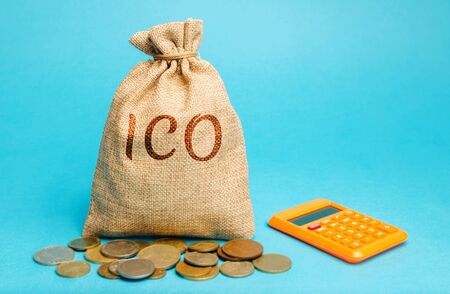 Money bag with the word ICO ( Initial coin offering ) and calculator. Attracting investments in the form of selling to investors a fixed number of new units of cryptocurrencies