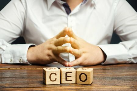 Wooden blocks with the word CEO and businessman. Chief Executive Officer. Boss, top management position in a team or company. Leader, Leadership. Business concept 版權商用圖片