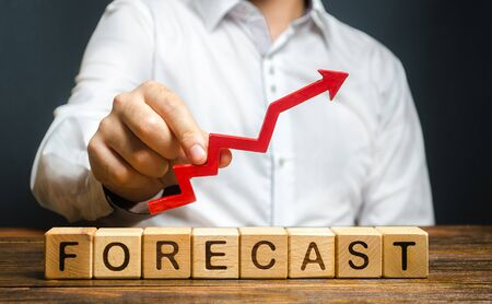 Man holds red arrow up over word Forecast. A budget surplus, prosperous economy or company. Prediction of profit growth, value of assets and market conditions. Increase income and earnings. Archivio Fotografico