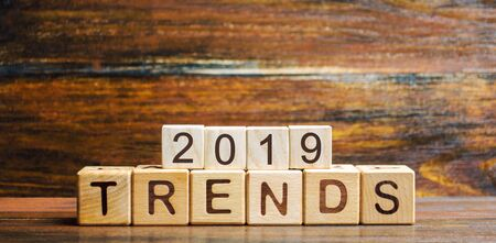 Wooden blocks with the word Trends 2019. Main trend of changing something. Popular and relevant topics. New ideological trends of fashion. Recent and latest trend. Evaluation methods. Fashionable 写真素材