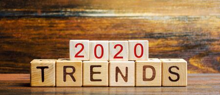 Wooden blocks with the word Trends 2020. Main trend of changing something. Popular and relevant topics. New ideological trends of fashion. Recent and latest trend. Evaluation methods. Fashionable 写真素材