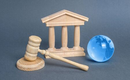 Courthouse, gavel and blue globe planet earth. International Court. Protection of business interests and human rights. international conventions and treaties. supreme