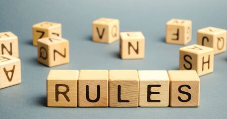 Wooden blocks with the word Rules. Setting rules, laws. Legislation. Religious and folk traditions. Stockfoto