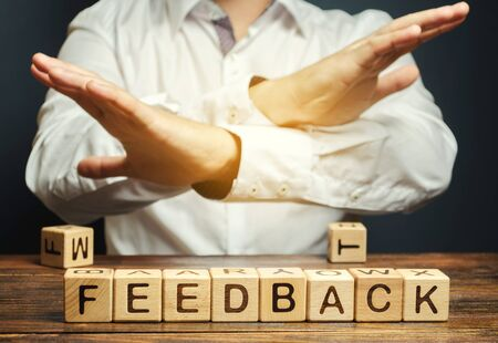 Wooden blocks with the word Feedback and critic. The concept of the bad rating of hotels and restaurants. The evaluation of visitors. Quality level, low service. Customer rating.