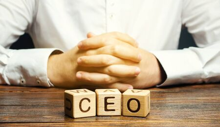 Wooden blocks with the word CEO and businessman. Chief Executive Officer. Boss, top management position in a team or company. Leader, Leadership. Business concept 스톡 콘텐츠