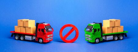 Prohibition sign NO between two trucks. Embargo trade wars. Restriction on importation, ban transit export dual-use goods to countries under sanctions. transport companies.