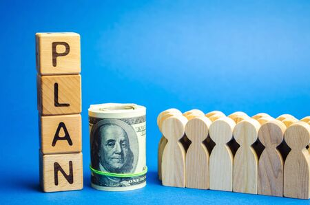 Wooden blocks with the word Plan and a business team standing next to money. Strategy planning. Management business concept. Improving the efficiency of the company's sales. Achieving financial target