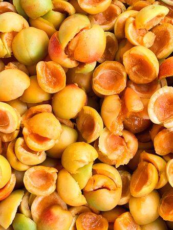 Sweet ripe juicy orange apricots. Fruit halves. The concept of the summer harvest, canning. Apricot day. Slices the workpiece to jam.