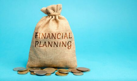 Money bag with the word Financial Planning. The plan of functioning and development of the enterprise. Business and finance concept. Budget, earnings, company profits. Tax deductions