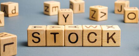 Wooden blocks with the word Stock. Trading on the stock exchange. Investment portfolio. Capital gains. Common and preferred stocks. Market trading and pricing. Share price determination. Stockfoto