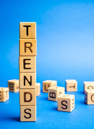 Wooden blocks with the word Trends. Popular and relevant topics. New ideological trends. Recent and latest trend.