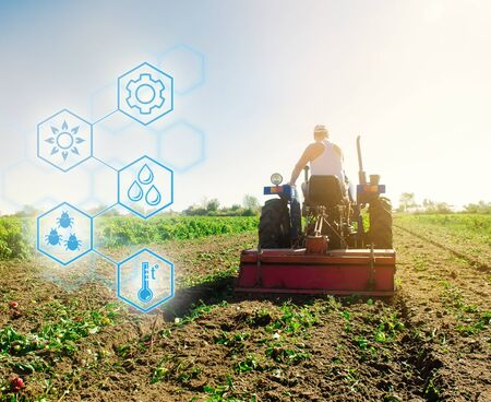 High technologies and innovations in agro-industry. Agricultural startup. Innovation. Automation and crop quality improvement. Tractor cultivates the soil after harvesting. A farmer plows a field. Stock Photo - 133610794