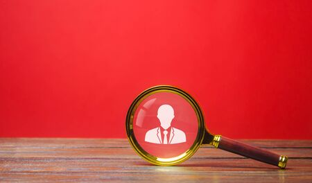 Magnifying glass and worker symbol. Recruitment concept. Hiring, hire. Human Resource Management. The concept of the search for people and employees. Employment Stock fotó